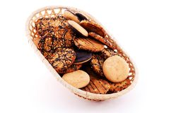Biscuit in the basket with nuts and chocolate Stock Photography