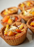 Biscuit baskets with fruit Stock Photography