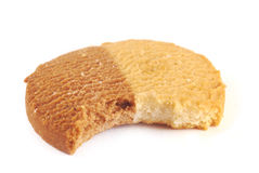 Biscuit with a bite taken out Stock Photos