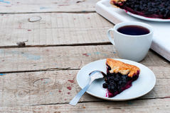 Biscuit with black currants and a cup of coffee Royalty Free Stock Images
