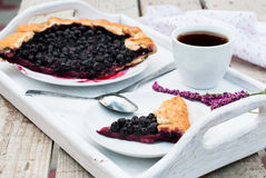 Biscuit with black currants and a cup of coffee Royalty Free Stock Photography