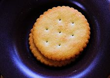 Biscuit in black plate Stock Image