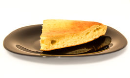 Biscuit on a black plate Stock Image