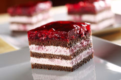 Biscuit cake. With raspberry cream and jelly royalty free stock photos