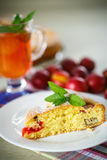 Biscuit cake with cherry plums Stock Images
