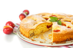 Biscuit cake with cherry plums Royalty Free Stock Images