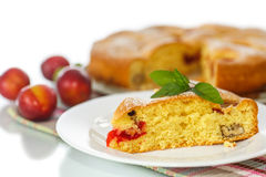 Biscuit cake with cherry plums Stock Photography