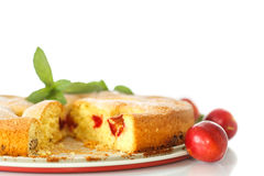 Biscuit cake with cherry plums Stock Photo