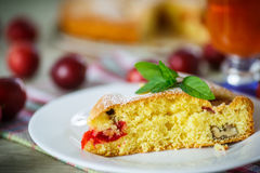 Biscuit cake with cherry plums Royalty Free Stock Photography