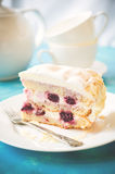 Biscuit cake with cream and a cherry Stock Images