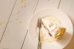 Biscuit cake with cream and a cherry Royalty Free Stock Photos