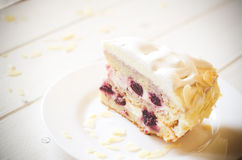 Biscuit cake with cream and a cherry Stock Image