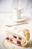 Biscuit cake with cream and a cherry Royalty Free Stock Image