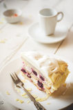 Biscuit cake with cream and a cherry Stock Photography