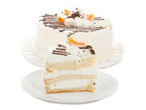 Biscuit cake with cream and dried apricots Stock Photo
