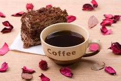 Biscuit cake with cup of coffee stock images