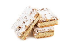 Biscuit cake decorated with powdered sugar Royalty Free Stock Photos