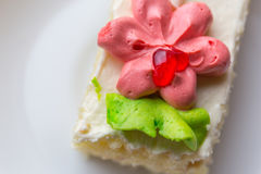 Biscuit cake decorated with red and green cream Stock Photography