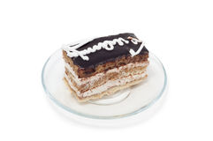 Biscuit cake decorated with white cream on plate Stock Photos