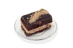 Biscuit cake with grated nuts on plate Royalty Free Stock Photo
