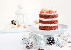 Biscuit cake with cream rose. Biscuit cake over Christmas decorations Royalty Free Stock Photos