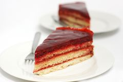 Biscuit cake with raspberry jam and jelly Stock Photos