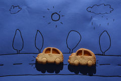 Biscuit cars on a blue sheet Royalty Free Stock Image