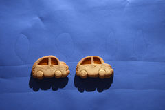 Biscuit cars on a blue sheet Stock Photo