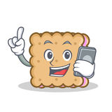 Biscuit cartoon character style with phone Stock Photos