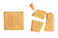 Biscuit cassé et parONU cassé d'isolement sur le fond blanc Photographie stock