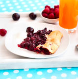 Biscuit with cherries and a glass of juice Stock Photos
