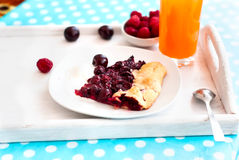 Biscuit with cherries and a glass of juice Royalty Free Stock Photo