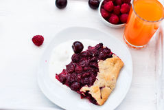 Biscuit with cherries and a glass of juice Royalty Free Stock Images