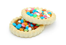 Biscuit with colored chocolate candy and jelly Stock Photos