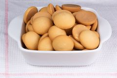 Biscuit cookies in a ceramic pot. On a towel Royalty Free Stock Photos