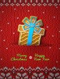 Biscuit de boîte-cadeau sur le fond tricoté Photo stock
