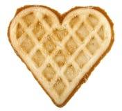 Biscuit de forme par un coeur Image libre de droits