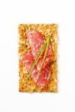 Biscuit de graine de citrouille avec le salami sec Photographie stock libre de droits