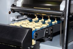 Biscuit depositing machine. Equipment in bakery industry Royalty Free Stock Image