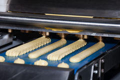 Biscuit depositing machine. Equipment in bakery industry Stock Photos