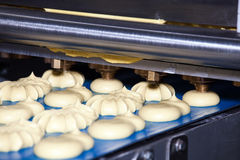 Biscuit depositing machine. Equipment in bakery industry Royalty Free Stock Photos