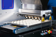 Biscuit depositing machine. Equipment in bakery industry Stock Photography