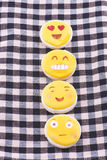 Biscuit with drawings of smiling and funny faces Royalty Free Stock Images