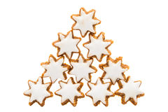Biscuit en forme d'étoile de Noël avec le glaçage blanc Photographie stock libre de droits