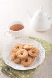 Biscuit et thé Photographie stock