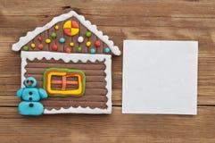Biscuit fait maison de maison de pain d'épice de Noël Image libre de droits