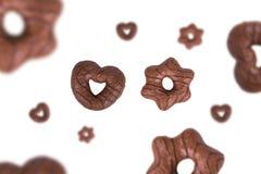 Biscuit formé de chocolat sur le blanc Photos libres de droits
