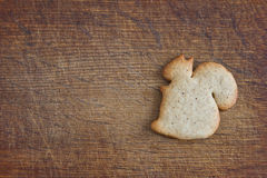 Biscuit in the form of figures of the squirrel. On the wooden background Stock Images