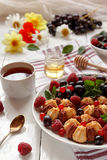 Biscuit with fresh berries on white plate. Selective focus. Biscuit with fresh berries on white plate. Selective focus Royalty Free Stock Photography