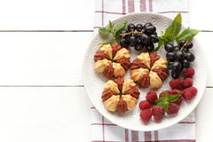 Biscuit with fresh berries on white plate. Selective focus. Copy space. Biscuit with fresh berries on white plate. Selective focus Royalty Free Stock Photos